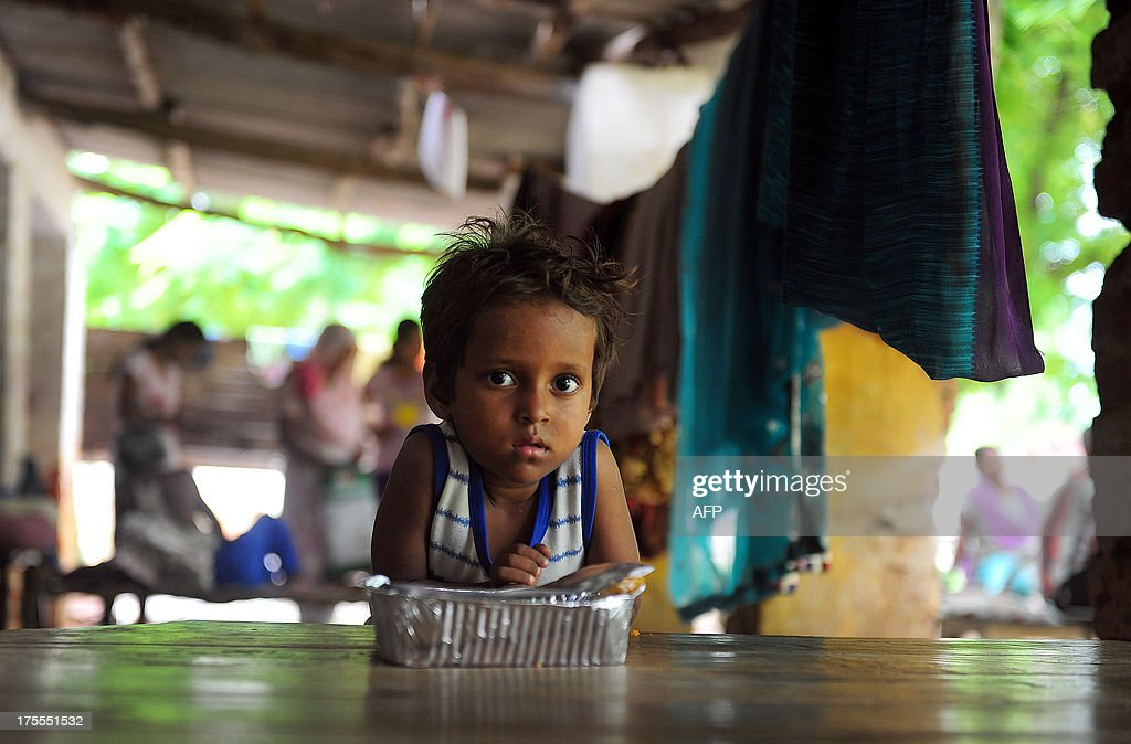 An Indian flood-affected boy plays at a local shelter in Allahabad on August 4, 2013. The monsoon, which covers the subcontinent from June to September and usually brings flooding, accounts for about 80 percent of India's annual rainfall.