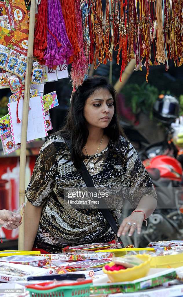 An Indian girl buys Rakhis ahead of Raksha Bandhan on August 7, 2014 in Noida, India. The festival of Raksha Bandhan' or 'Rakhi' celebrate the brother-sister love. Sisters tie sacred Rakhi string on their brothers' right wrists and pray for their protection.