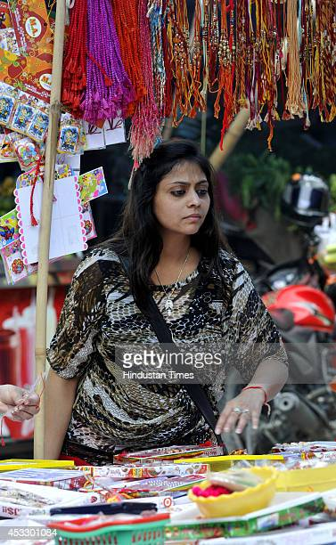An Indian girl buys Rakhis ahead of Raksha Bandhan on August 7 2014 in Noida India The festival of Raksha Bandhan' or 'Rakhi' celebrate the...