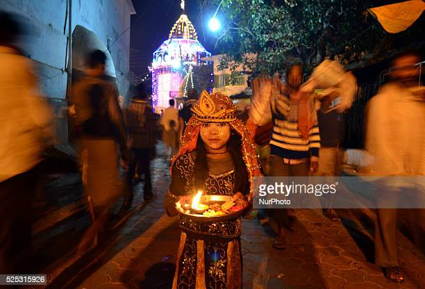 An indian girl dressed as Hindu Goddess asks for money at Ramghaton the banks of Mandakini River on ocassion of Diwali festivalat Chitrakootabout 128...