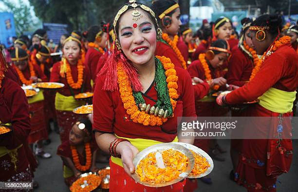 An Indian girl of Nepali origin poses for a photograph as she prepares before performing during the inauguration of the Darjeeling Tea and Tourism...