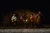 TOPSHOT An Indian girl studies by candle light in a slum area without electric power in Phillaur around 50 km from Jalandhar on February 29 2016...
