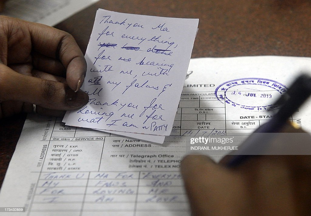 An Indian girl writes a message from her mother to send as a telegram to her grandmother at a counter in Mumbai on July 14, 2013. Thousands of Indians crammed into telegram offices to send souvenir messages to friends and family in a last-minute rush before the service shuts down. July 14, 2013, is the last day that messages will be accepted by the 162-year-old service, the last major commercial telegram operation. In the days before mobile phones and the Internet, the telegram network was the main form of long-distance communication, with 20 million messages dispatched from India during the subcontinent's bloody partition in 1947. AFP PHOTO / INDRANIL MUKHERJEE