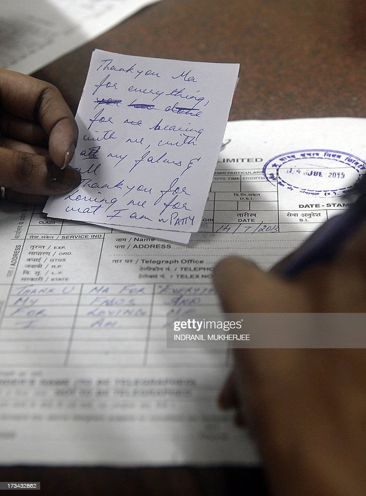 An Indian girl writes a message from her mother to send as a telegram to her grandmother at a counter in Mumbai on July 14, 2013. Thousands of Indians crammed into telegram offices to send souvenir messages to friends and family in a last-minute rush before the service shuts down. July 14, 2013, is the last day that messages will be accepted by the 162-year-old service, the last major commercial telegram operation. In the days before mobile phones and the Internet, the telegram network was the main form of long-distance communication, with 20 million messages dispatched from India during the subcontinent's bloody partition in 1947.