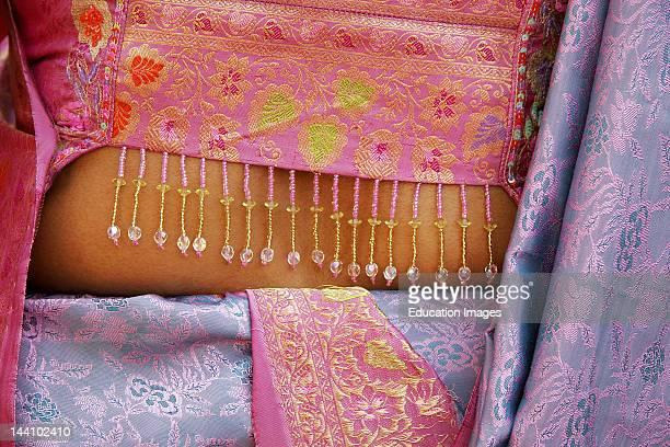 An Indian Gujarati Woman Wearing A Decorated Brocade Blouse And Sari India