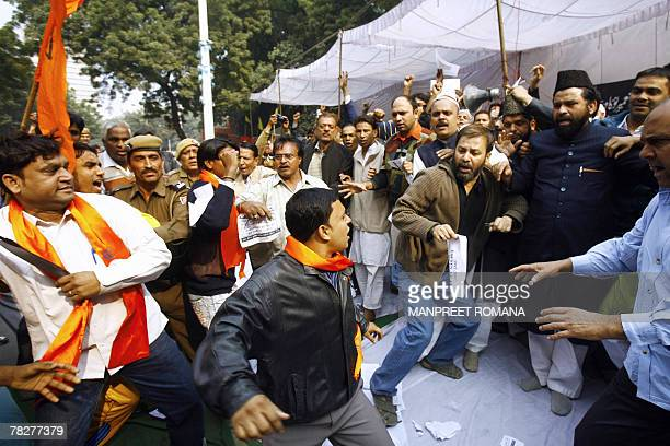 An Indian Hindu activist faces off with a Muslim activist during a clash between Hindu and Muslim protestors in New Delhi 06 December 2007 on the...