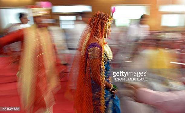 An Indian Hindu bride and groom arrive for a multifaith mass wedding in Mumbai on June 22 2014 Over 50 underprivileged couples from different...