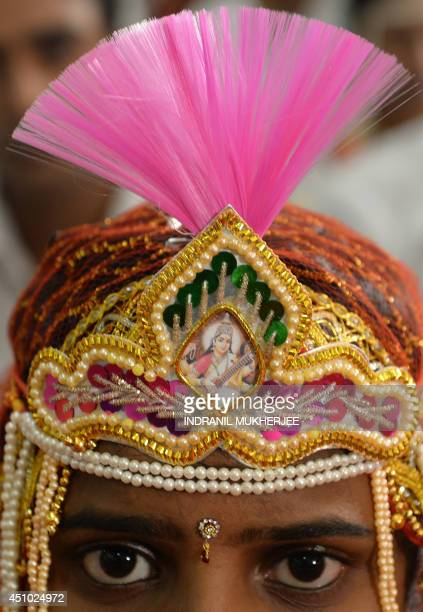 An Indian Hindu bride looks on during a multifaith mass wedding in Mumbai on June 22 2014 Over 50 underprivileged couples from different communities...