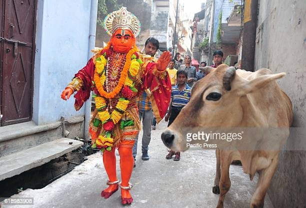 An Indian Hindu devotee dressed as monkey god Hanuman take part in a religious procession as part of the Hindu festival of Hanuman Jayanti in...