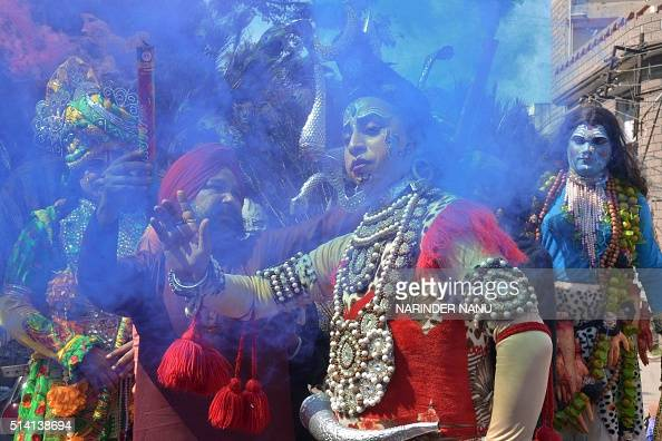 An Indian Hindu devotee dressed as the deity Shiva takes part in a procession during the Maha Shivaratri festival in Amritsar on March 7 2016 The...