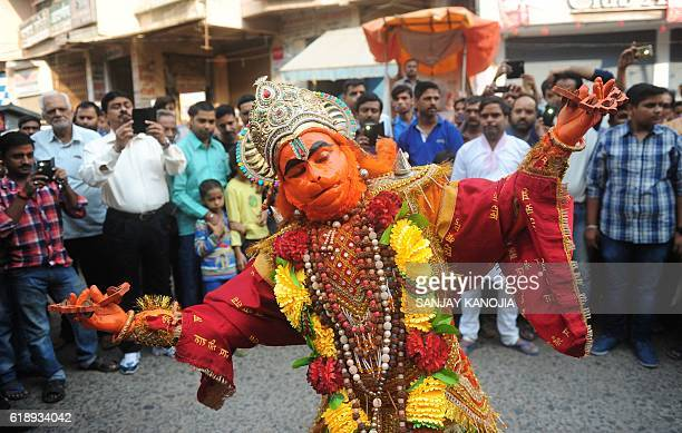 An Indian Hindu devotee dressed as the monkey god Hanuman dances during a religious procession as part of the Hindu festival of Hanuman Jayanti in...