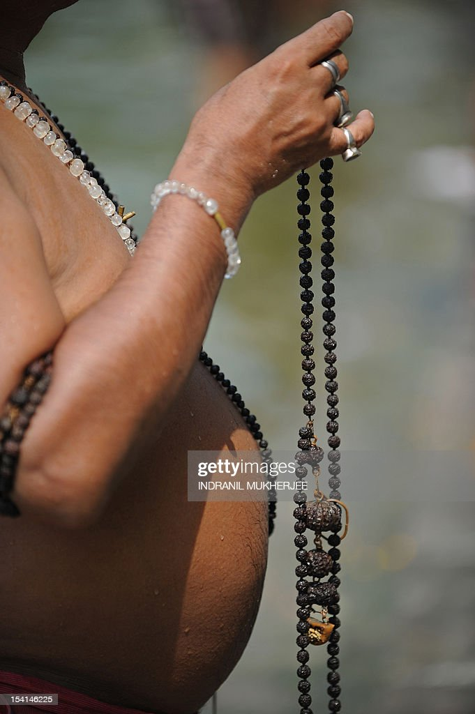 An Indian Hindu devotee performs 'Tarpan', a ritual to pay obesience to one's forefathers, on the last day for offering prayers to ancestors called 'Pitrupaksh' in Mumbai on October 15, 2011. In Hindu mythology, this day is also called 'Mahalaya' and described as the day when the gods created the ten armed goddess Durga to destroy the demon king Asura who plotted to drive out the gods from their kingdom. The five-day period of worship of Durga, who is attributed as the destroyer of evil, commences on October 20. AFP PHOTO/Indranil MUKHERJEE