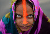 An Indian Hindu devotee poses for a photograph as she offers prayers a day ahead of the Chhat festival on the Yamuna river in New Delhi on October 28...