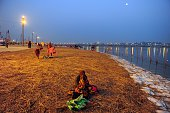 An Indian Hindu devotee rests after taking a dip at Sangam the confluence of the Rivers Ganges Yamuna and mythical Saraswati during the annual Magh...
