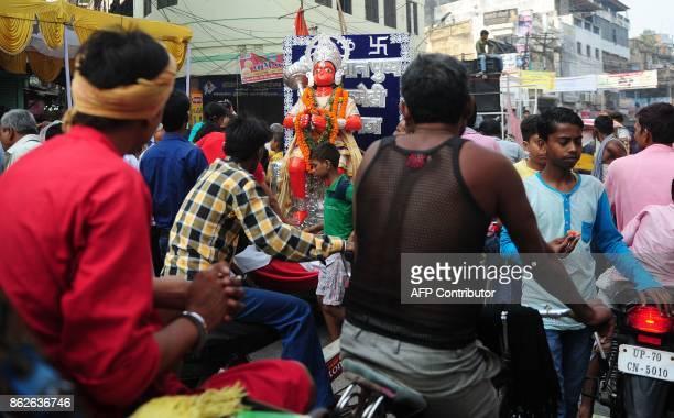 An Indian Hindu devotees watch a procession for the Hindu festival Hanuman Jayanti in Allahabad on October 18 2017 Hanuman Jayanti commemorates the...