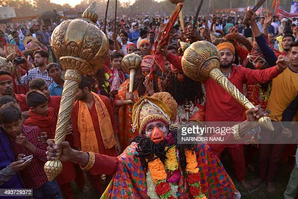 An Indian Hindu dressed as the monkey god Hanuman participates in a religious procession at the grounds in Amritsar on October 22 on the occasion of...