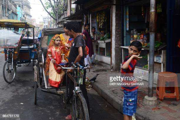 An Indian Hindu girl arrives to take part in the Kumari Puja at the Adyapeath Ashram on the outskirts of Kolkata on April 5 2017 Kumari Puja a...