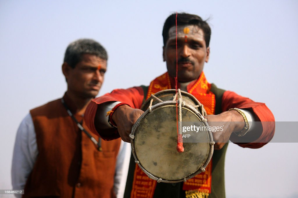 An Indian Hindu priest performs a ritual for a peaceful Kumbh Mela during a ceremony in Allahabad on December 17, 2012. The Kumbh Mela which is scheduled to take place in the northern Indian city in January and February 2013, is the largest gathering of people for a religious purpose in the world and millions of people gather for this auspicious occasion. AFP PHOTO/Sanjay KANOJIA