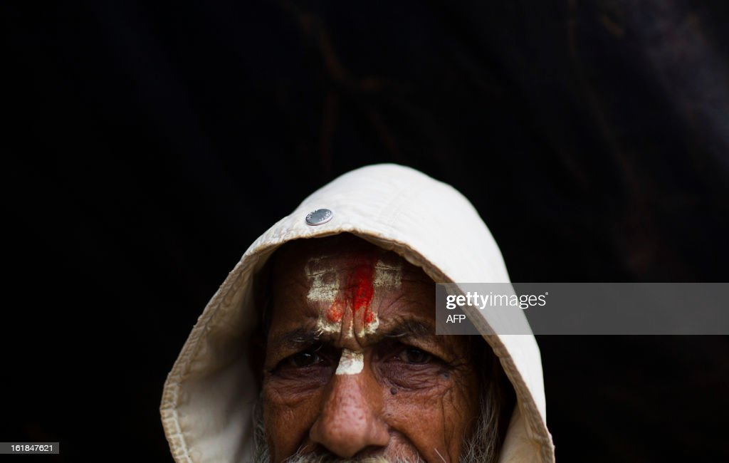 An Indian Hindu Sadhu poses for a photo at the Kumbh Mela in Allahabad on February 17, 2013. The Kumbh Mela in the town of Allahabad will see up to 100 million worshippers gather over 55 days to take a ritual bath in the holy waters, believed to cleanse sins and bestow blessings. AFP PHOTO/ Andrew Caballero-Reynolds