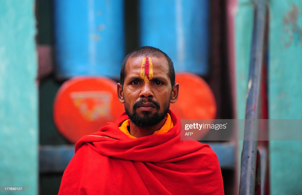 An Indian Hindu VHP members looks on before attempting a procession with other members in Ayodhya on August 25, 2013. Indian police arrested leaders of a Hindu forum to try and prevent a march to a pilgrimage town where the 1992 razing of a mosque sparked deadly sectarian riots. Organisers from the Vishwa Hindu Parishad (VHP, World Hindu Council) and the Press Trust of India (PTI) said some 125 people were detained in the northern state of Uttar Pdaesh.