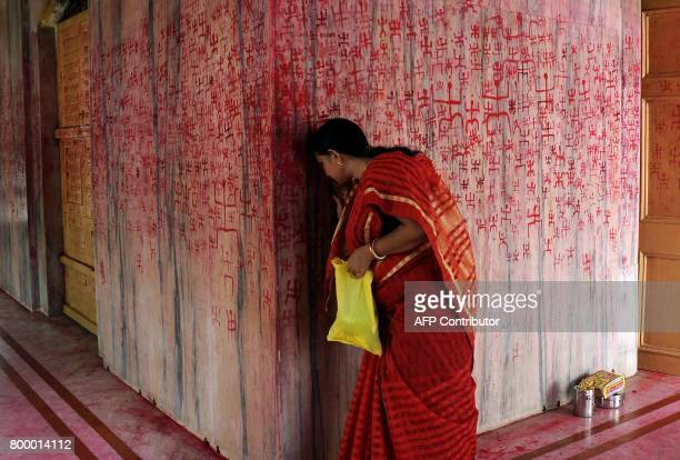 TOPSHOT An Indian Hindu woman prays as she takes part in a ritual offering during the Ambubachi festival at a temple in Agartala the capital of...