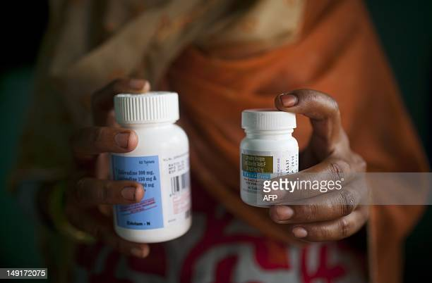 An Indian HIVinfected women poses with her antiretroviral drugs at her home in New Delhi on July 23 2012 New HIV cases among adults have declined by...
