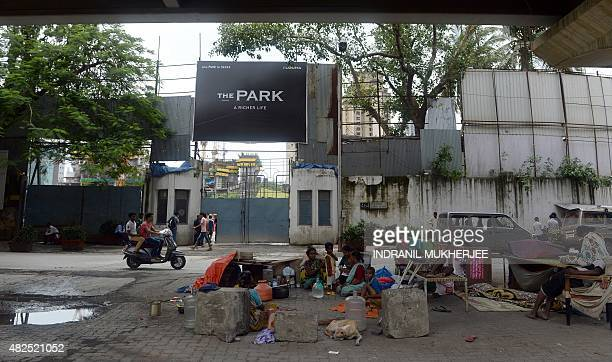 An Indian homeless family rests under a bridge adjacent to the underconstruction luxury apartment block 'The Park' also dubbed as 'Trump Tower' in...