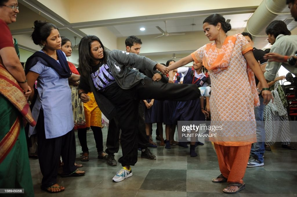 An Indian instructor (3L) shows a self defence technique to a participant during a self-defence classes at a school in Mumbai on January 4, 2013. After nearly three weeks of lurid reporting on a horrifying gang-rape in New Delhi, women in the Indian capital say they are more anxious than ever, leading to a surge in interest in self-defence classes.