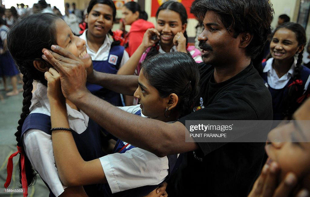 An Indian instructor (2R) shows a self-defence technique to school girls during a self-defence class at a school in Mumbai on January 4, 2013. After nearly three weeks of lurid reporting on a horrifying gang-rape in New Delhi, women in the Indian capital say they are more anxious than ever, leading to a surge in interest in self-defence classes.