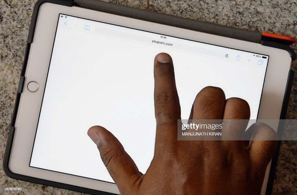 An Indian internet user points out at a porn site showing a blank screen after being blocked by the internet service providers based on directive...