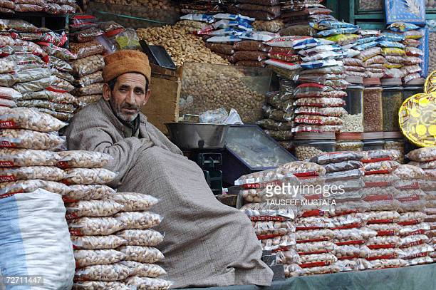 An Indian Kashmiri dry fruits seller waits for customers in Kashmir's summer capital Srinagar 04 December 2006 Temperatures have dipped sharply in...