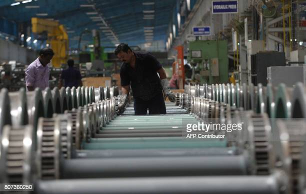 An Indian labourer works on an assembly line at Integral Coach Factory during the construction of an Indian Railways locomotive coach in Chennai on...