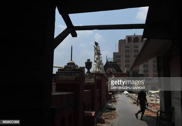 An Indian labourer works on the renovation of the historic Writers' Building in Kolkata on World Heritage Day on April 18 2017 The redbrick complex...