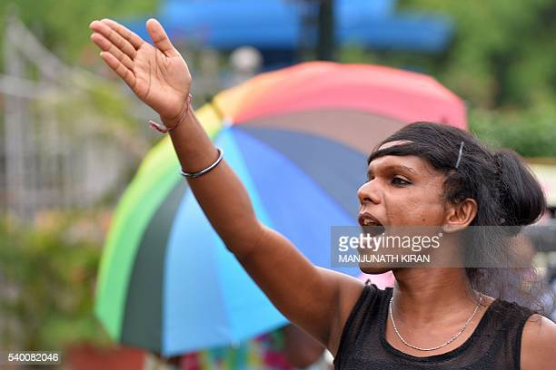 An Indian LGBT activist shouts slogans during a demonstration and candlelight vigil held in Bangalore on June 14 condemning the killing of 49 people...