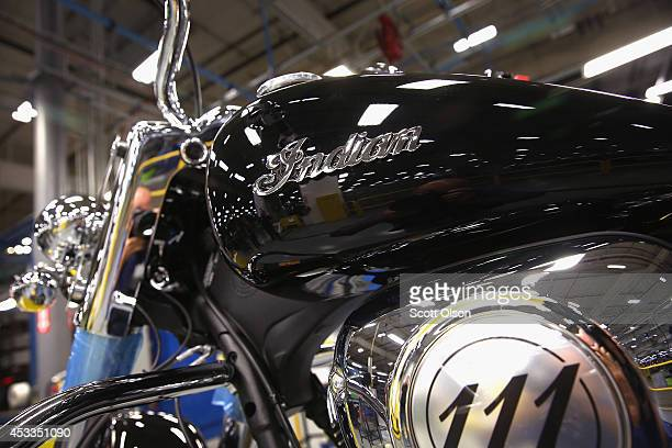 An Indian logo decorates the gas tank of an Indian Chief Vintage motorcycle sitting on the assembly line at the Polaris Industries factory on August...