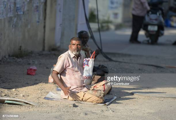 An Indian man begs on the side of the road in Hyderabad on November 10 2017 A city in southern India has banned begging in public places ahead of a...