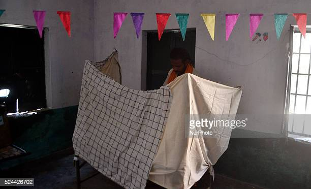 An indian man casts his vote in a polling centre first phase of Panchayat elections in Rampur23 kms from Allahabad on October 92015
