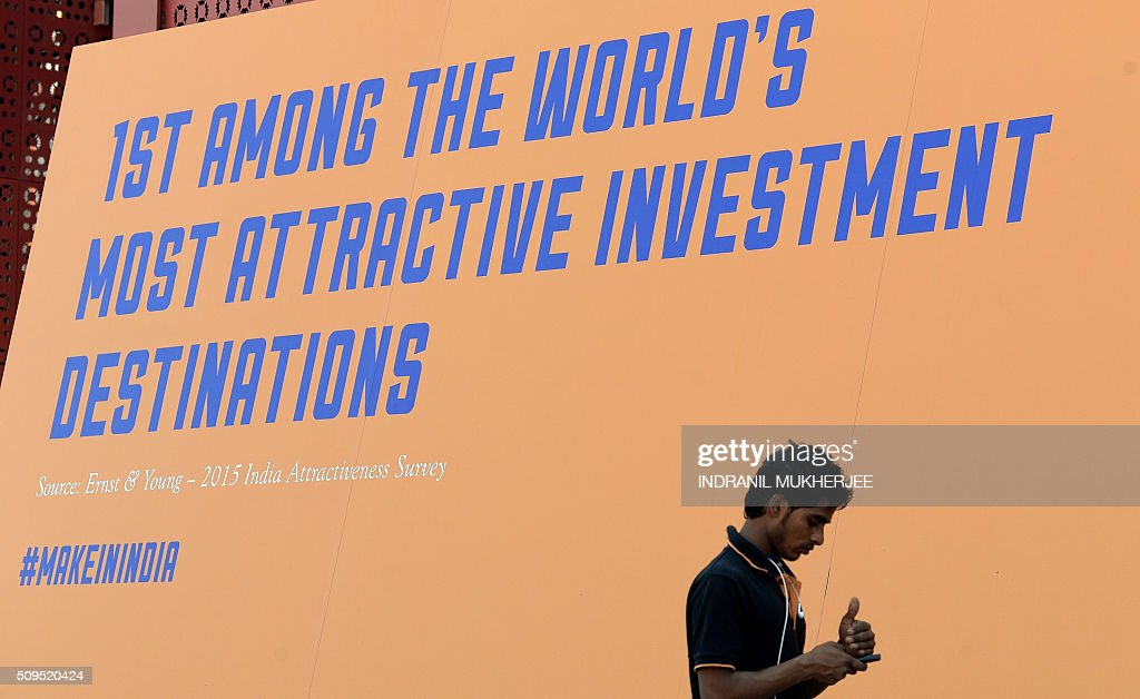 An Indian man checks his phone at the venue for the 'Make in India' showcase week in Mumbai on February 11, 2016. Over 190 companies, including national conglomerates and multinational corporations, 5,000 delegates from 60 countries, and leading industrialists including Ratan Tata and Mukesh Ambani will be participating in the maiden 'Make in India' showcase to be held in Mumbai from February 13-18. AFP PHOTO/ INDRANIL MUKHERJEE / AFP / INDRANIL MUKHERJEE