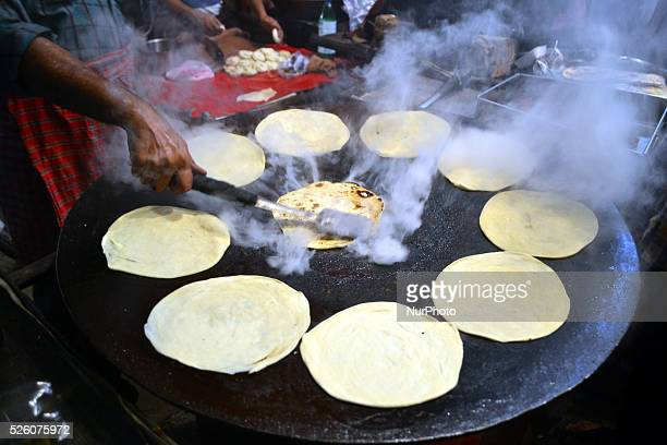 An indian man cooks parantha in a restaurent during last day of holy month of Ramadan ahead of Holy festival EidulFitrin Allahabad on July 172015