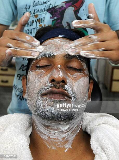 An Indian man has a facial massage at a men's beauty saloon in New Delhi on July 15 2010 'Indian men want to have the 'oomph' factor' Murali K Menon...