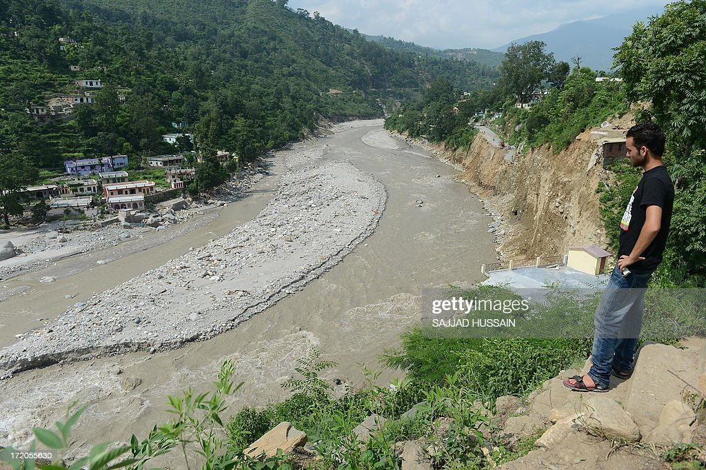 An Indian man looks at the flood damage at Silli, in the flood affected area of northern Uttarakhand state on July 1, 2013. Construction along river banks will be banned in a devastated north Indian state amid concerns unchecked development fuelled last month's flash floods and landslides that killed thousands, the state's top official said July 1.