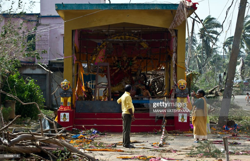 An Indian man looks on amid debris at a damaged pandal, a place of worship, in Gopalpur on October 13, 2013. Cyclone Phailin left a trail of destruction along India's east coast and up to seven people dead after the biggest evacuation in the country's history helped minimise casualties.
