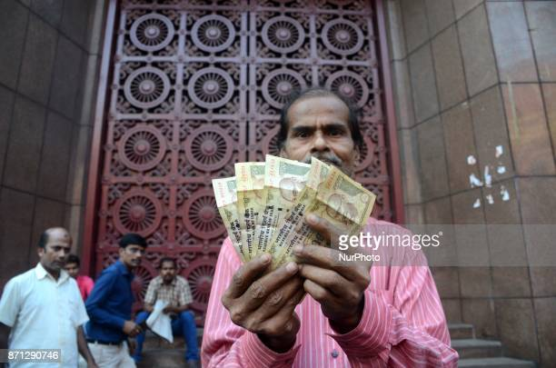 An Indian man showing banned 500 rupee notes in front of Reserve Bank in Kolkata India on Tuesday 7th November 2017 Indian Prime Minister Narendra...