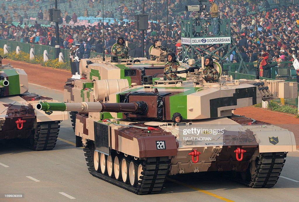 An Indian MBT Arjun MK-1 tank rolls down Rajpath during the final full dress rehearsal for the Indian Republic Day parade in New Delhi on January 23, 2013. India will celebrate the 64th Republic Day on January 26 with a large military parade. AFP PHOTO/ RAVEENDRAN