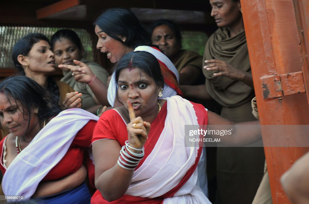 An Indian member of National Federation of Indian Women (NFIW) argues with police during a protest against the increasing violence against women in the country in Hyderabad on November 24, 2012. NFIW demands action against the recent rise of violence and oppression against women. AFP PHOTO / Noah SEELAM