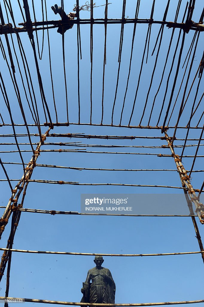 An Indian migrant labourer prepares a makeshift bamboo scaffolding for a function in Mumbai on January 28, 2013. Migrant labourers from adjoining cities and states come to India's commercial capital in search of a livelihood as the city is seeing record levels of expansion and is still considered to be an oasis for potential job-seekers.