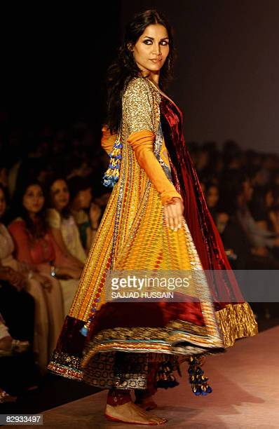 An Indian model display a creation by Indian designer Manish Malhotra on the final day of the HDIL India Couture Week in Mumbai on September 21 2008...