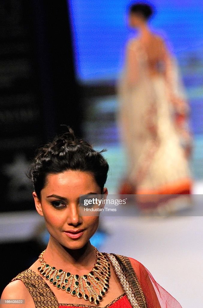 An Indian model displays a creation during a fashion show at the Indian Gem and Jewellery Fair on April 12, 2013 in New Delhi, India. Over 100 jewellers and designers are participating in the IGJF held from 12th - 15th April, 2013. One of the largest market of gold, India imported $39.5 billion of gold in first nine months of last fiscal and exported gold jewellery to the tune of $12.12 billion in the same period.