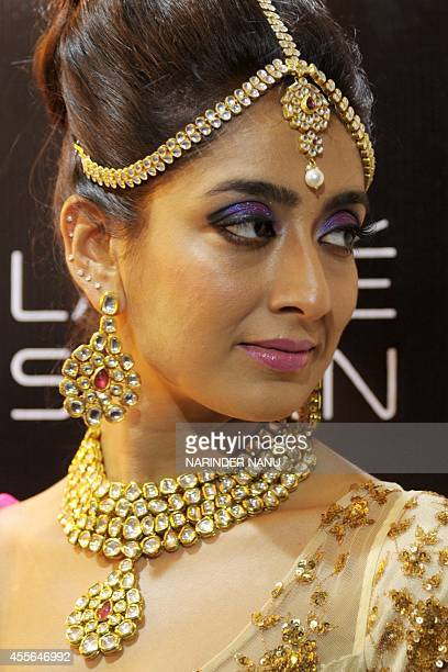 An Indian model displays bridal wear during a bridal makeup workshop at Lakme Salon in Amritsar on September 18 2014 The workshop in the northern...