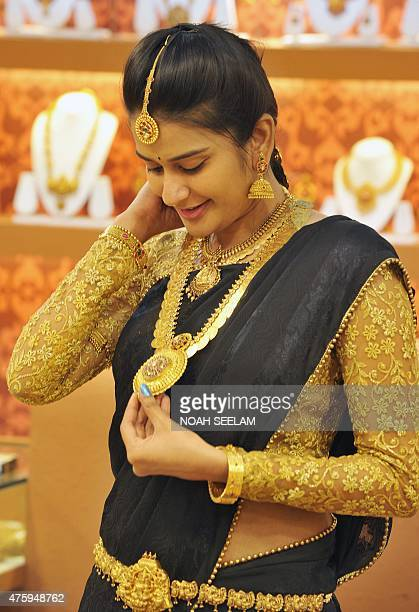 An Indian model poses for a photograph wearing jewellery displayed during the Hyderabad Jewellery Pearl and Gem Fair in Hyderabad on June 5 2015 Over...